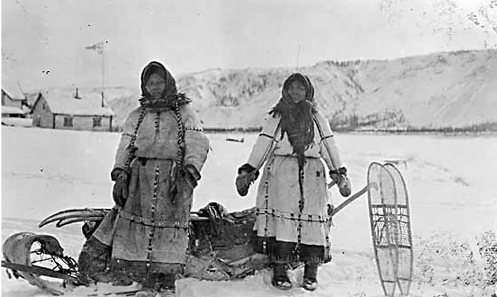 2 women in caribou coats at Rampart House, 1920s